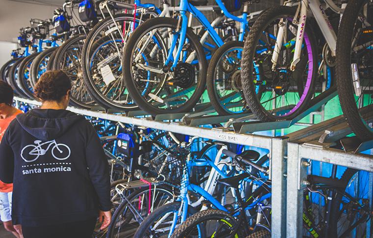 employee browsing bike racks at the rental center