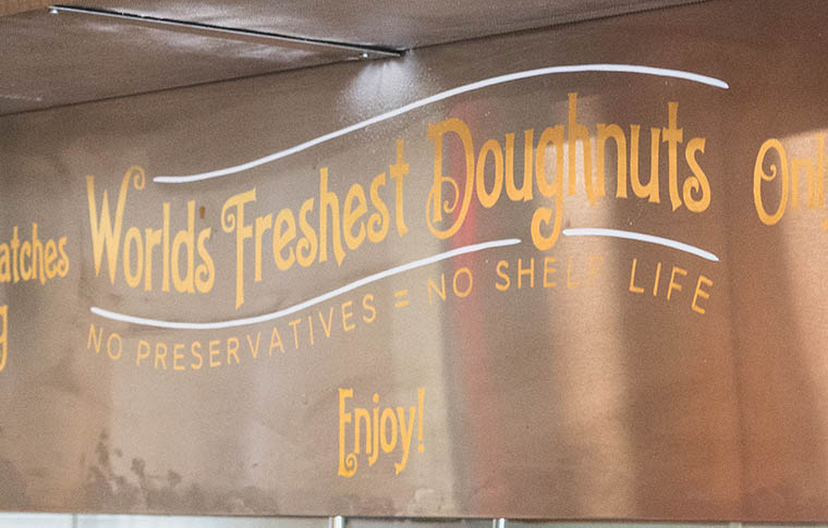 A sign for one of the stops reading 'World's Freshest Doughnuts'