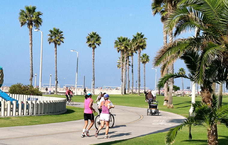 people running and bicycling near santa monica beach