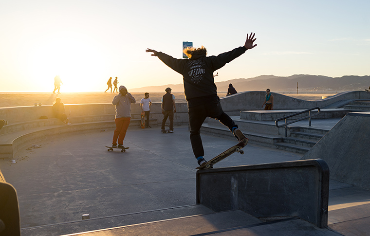 skaters performing stunts in a skatepark