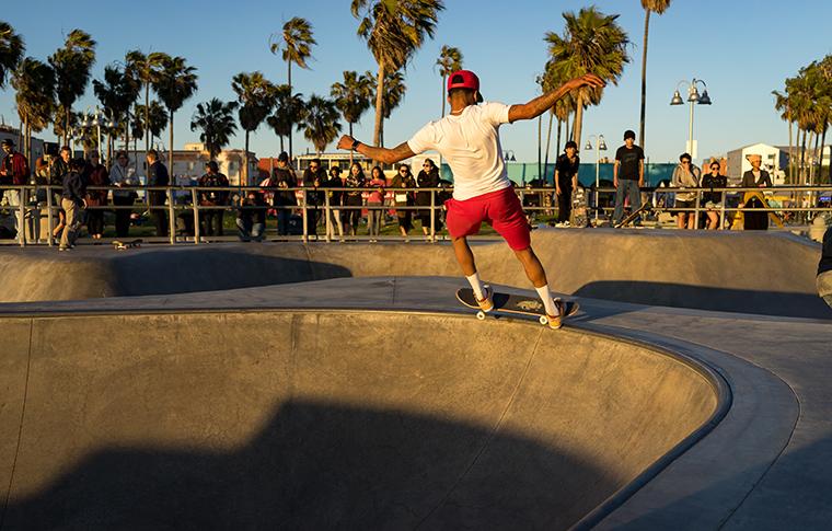 man grinding in a skatepark