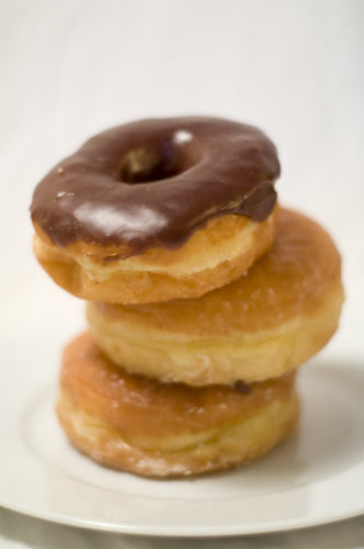 a stack of three doughnuts